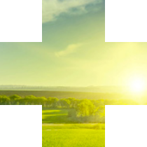 plus symbol containing horizon at sunset over green fields